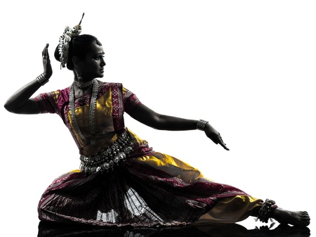 india dance: one indian woman dancer dancing in silhouette studio isolated on white background Stock Photo