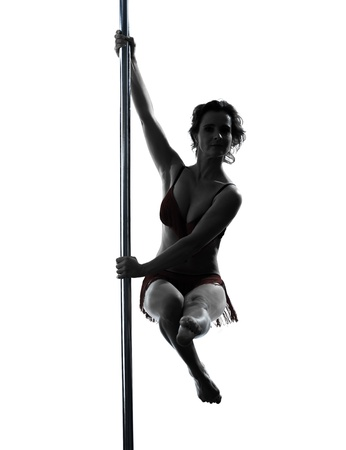 one caucasian woman pole dancer dancing in silhouette studio isolated on white background Stock Photo - 17798138