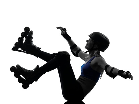 one caucasian woman in roller skates  falling silhouette studio isolated on white background photo