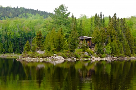 landscape: cabin hut house by the lake of sacacomie  in quebec canada