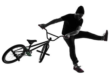 bmx: one caucasian man exercising bmx acrobatic figure in silhouette studio isolated on white background