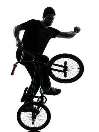 figure out: one caucasian man exercising bmx acrobatic figure in silhouette studio isolated on white background