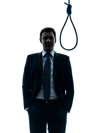 one caucasian man judge standing in front of hangman's noose in silhouette studio isolated on white background Stock Photo - 18238096