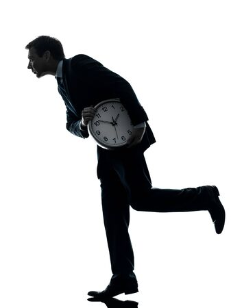 'hide out': one caucasian businessman holding clock robbing time  in silhouette studio isolated on white background
