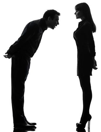 one caucasian couple woman seducing man in silhouette studio isolated on white background photo