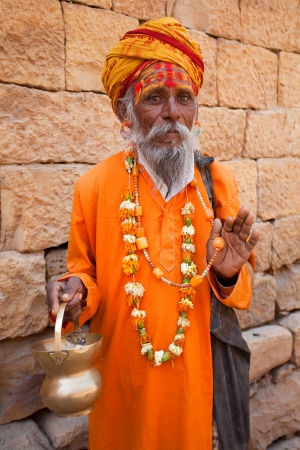 jainism: jain priest welcoming saluting in jaisalmer in rajasthan state in india Editorial