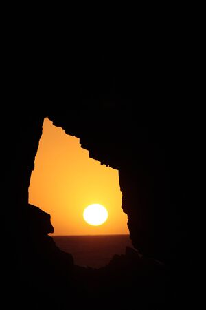 jeriquaquara: sunset inside the pedra furada bored rock beach main attraction in the beautiful fisherman village of Jericoacoara in ceara state brazil Stock Photo