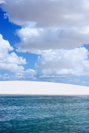 view of lagoa azul in desert sand dunes of the Lencois Maranheses National Park in brazil photo
