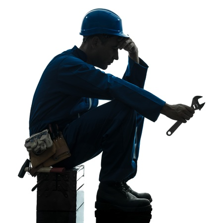 tired worker: one caucasian repairman worker sad fatigue failure  silhouette in studio on white background Stock Photo