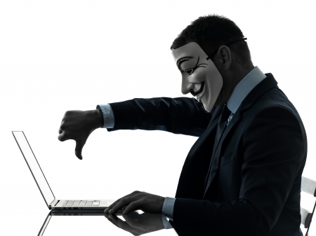 PARIS– OCTOBER 30   one man dressed and masked as a  member of Anonymous underground group member computing computer  on October 30, 2012 in Paris ,France