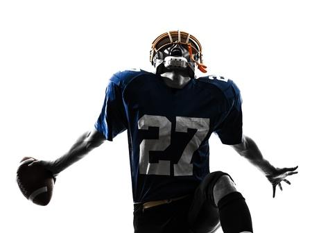 uniforme de futbol: un jugador de f�tbol americano cauc�sico hombre triunfante en el estudio de la silueta aislado en el fondo blanco
