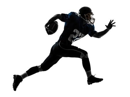 uniforme de futbol: un hombre caucásico de fútbol americano jugador que corre en el estudio de la silueta aislado en el fondo blanco Foto de archivo