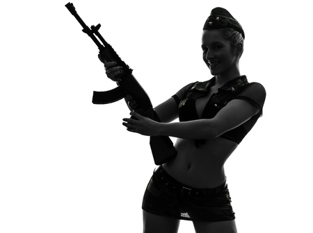 one caucasian sexy woman in army uniform holding kalachnikov in silhouette studio isolated on white background Stock Photo - 18353472