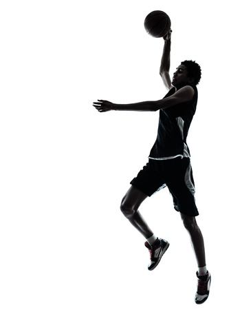 a basketball player: one young man basketball player silhouette in studio isolated on white background Stock Photo