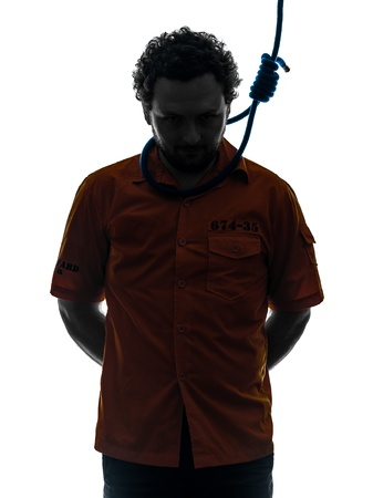 one caucasian criminal man with hangman noose around the neck in silhouette studio isolated on white background photo
