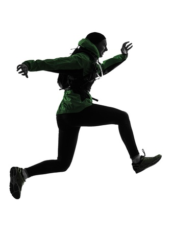 joggers: one caucasian woman runner running trekking  in silhouette studio isolated on white background Stock Photo