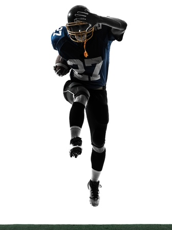 one caucasian american football player man running   in silhouette studio isolated on white background photo