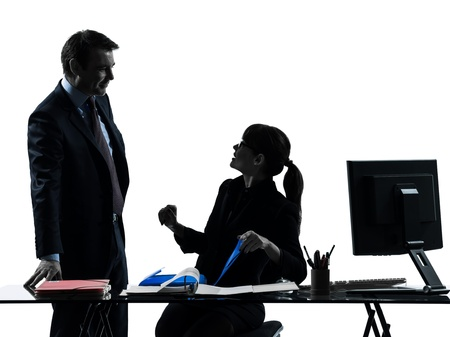 two people talking: one caucasian busy smiling business woman man couple  in silhouette studio isolated on white background Stock Photo