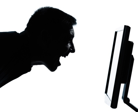 one caucasian business man face happy screaming silhouette with computer screen display portrait in studio isolated on white background photo