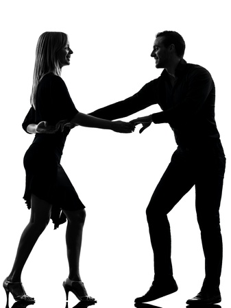 ballroom dance: one caucasian couple woman man dancing dancers salsa rock  in silhouette studio isolated on white background