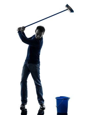 brooming: one caucasian man janitor brooming cleaner  golfing full length in silhouette studio isolated on white background