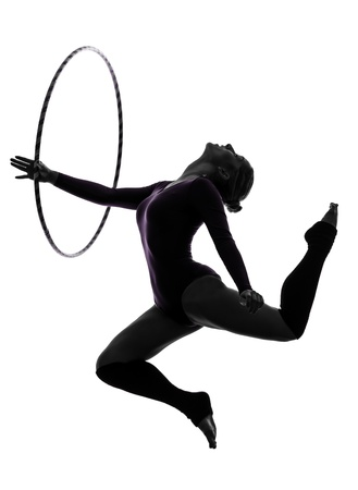 rhythmic gymnastics: one caucasian woman exercising Rhythmic Gymnastics hula hoop  in silhouette studio isolated on white background
