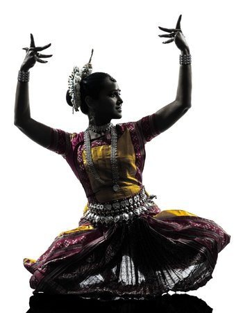 indian dance: one indian woman dancer dancing in silhouette studio isolated on white background Stock Photo