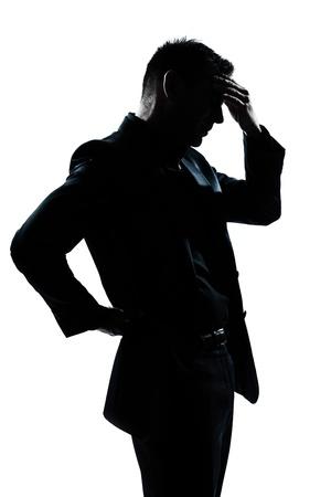 one caucasian man portrait silhouette tired migraine backache in studio isolated on white background