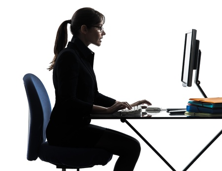 one caucasian business woman computer computing typing  in silhouette studio isolated on white background photo