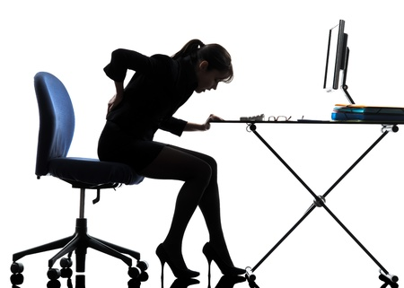 backache: one caucasian business woman sitting backache pain in silhouette studio isolated on white background