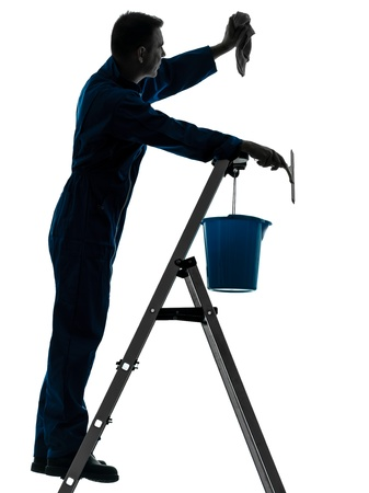 house cleaner: one caucasian man house worker janitor cleaning window cleaner silhouette in studio on white background