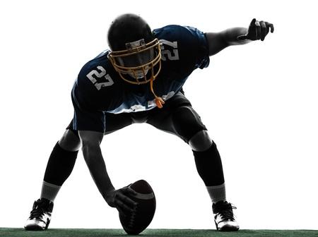 jugador de futbol: un centro de jugador de f�tbol americano hombre en el estudio de la silueta aislado en el fondo blanco