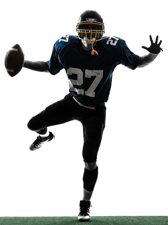 american football background: one caucasian american football player man triumphant in silhouette studio isolated on white background Stock Photo