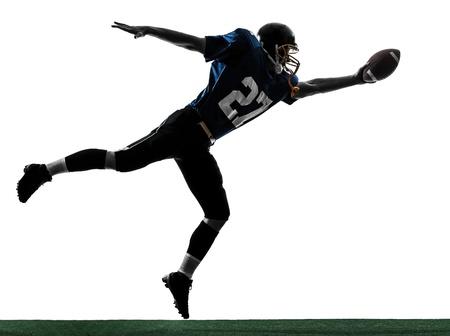fuball spieler: ein caucasian american football player Mann Scoring Touchdown in der Silhouette Studio isoliert auf wei�em Hintergrund Lizenzfreie Bilder