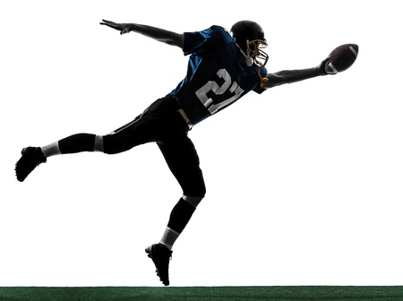 one caucasian american football player man scoring touchdown   in silhouette studio isolated on white background photo