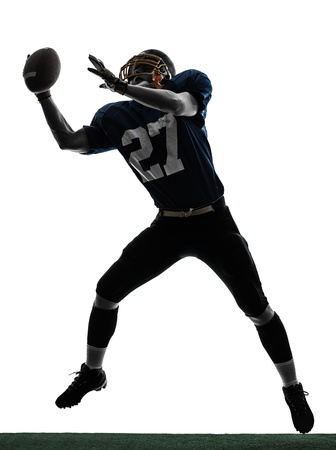 catching: one caucasian american football player man catching receiving in silhouette studio isolated on white background