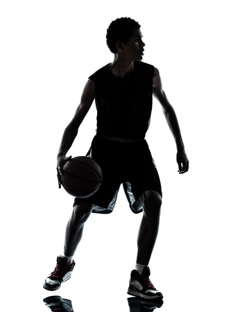 one young man basketball player silhouette in studio isolated on white background photo