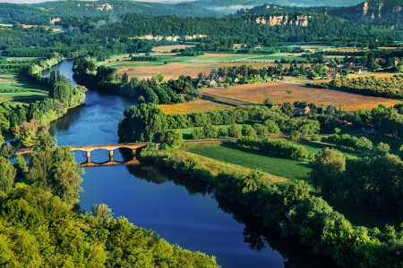 aquitaine: medevial bridge over the dordogne river perigord france