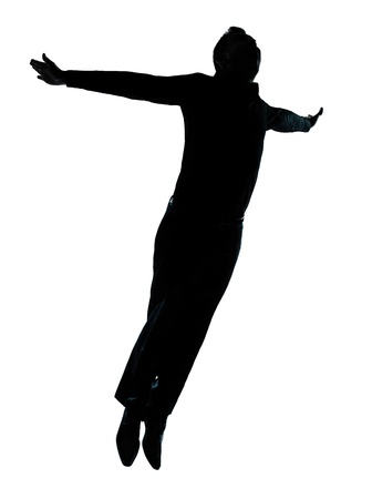 flying man: one caucasian business man  jumping flying wellness silhouette Full length in studio isolated on white background