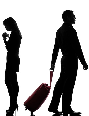 divorcing: one caucasian couple man and woman dispute separation in studio silhouette isolated on white background