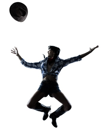 one woman cowgirl  dancer happy dancing country music in studio isolated on white background photo
