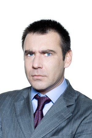 Closeup portrait of a serious angry mature man in studio on isolated white background