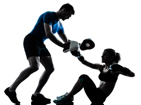 kickboxing: one caucasian couple man woman personal trainer coach man woman boxing training silhouette studio isolated on white background Stock Photo