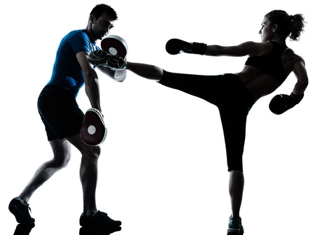combative sport: one caucasian couple man woman personal trainer coach man woman boxing training silhouette studio isolated on white background Stock Photo