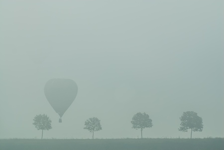 Hot Air Balloon gathering in the fog of  countryside of France Stock Photo - 18686857