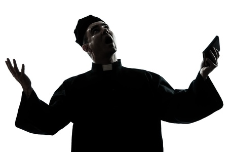 one caucasian man priest silhouette in studio isolated on white background photo