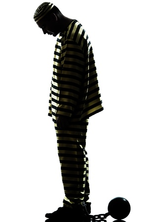costume ball: one caucasian man prisoner criminal with chain ball in studio isolated on white background Stock Photo