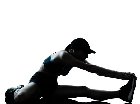 leg calf injury: one caucasian woman runner jogger stretching legs warming up in silhouette studio isolated on white background