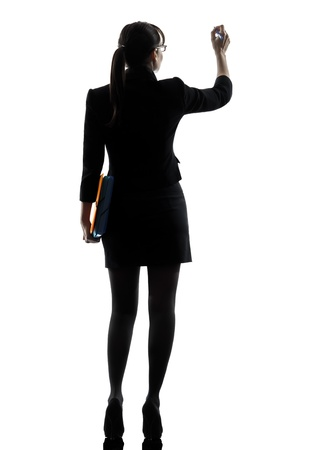 one caucasian business woman writing holding folders files in silhouette studio isolated on white background Stock Photo - 18632797
