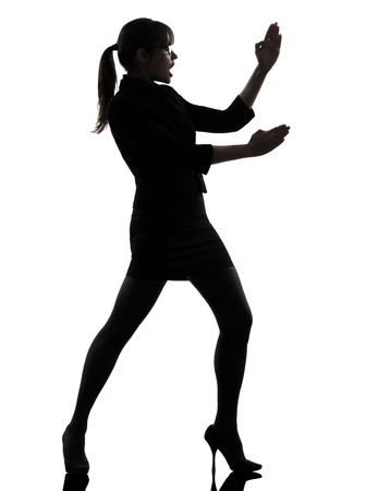 one caucasian business woman karate self defense  in silhouette studio isolated on white background photo